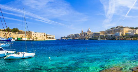 Panoramic,View,Of,Valetta,With,Sailing,Boats,In,Turquoise,Sea.